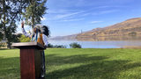 JoDe Goudy, chairman of the Yakama Nation, speaks with the Columbia River in the background near The Dalles, Oregon, on Monday, Oct. 14, 2019, where Celilo Falls, an ancient salmon fishing site was destroyed by the construction of the Dalles Dam in the 1950s. (AP Photo/Gillian Flaccus)