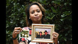 """In this Sept. 6, 2019, photo, Donna Cryer holds up family photos that include her father Roland Henry, as she poses for a photo in Washington. When her father died, she tried to donate his organs, yet the local organ collection agency said no, without talking to the family or providing a reason. """"It was devastating to be told there was nothing they considered worthy of donation. Nada. Not a kidney, not a liver, not tissue,"""" recalled Donna Cryer, president of the nonprofit Global Liver Institute and herself a recipient of a liver transplant. (AP Photo/Susan Walsh)"""