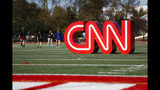 A CNN sign rests on an athletic field outside the Clements Recreation Center where the CNN/New York Times will host the Democratic presidential primary debate at Otterbein University, Monday, Oct. 14, 2019, in Westerville, Ohio. (AP Photo/John Minchillo)