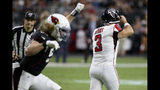 Atlanta Falcons kicker Matt Bryant (3) reacts to missing the point after as Arizona Cardinals linebacker Brooks Reed celebrates during the second half of an NFL football game, Sunday, Oct. 13, 2019, in Glendale, Ariz. The Cardinals won 34-33. (AP Photo/Ross D. Franklin)