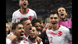 Turkey players celebrated after the end of the Euro 2020 group H qualifying soccer match between France and Turkey at Stade de France at Saint Denis, north of Paris, France, Monday, Oct. 14, 2019. The match ended 1-1. (AP Photo/Thibault Camus)