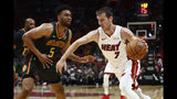 Miami Heat guard Goran Dragic (7) dribbles against Atlanta Hawks forward Jabari Parker (5) during the second half of an NBA preseason basketball game Monday, Oct. 14, 2019, in Miami. (AP Photo/Brynn Anderson)