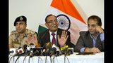 Government spokesperson Rohit Kansal, center, speaks as Swayam Prakash Pani, Inspector General of Police of Kashmir Range, left, and Divisional Commissioner Baseer Khan sit beside him during a press conference in Srinagar, Indian controlled Kashmir, Saturday, Oct. 12 2019. Around 4 million post-paid cellphone connections will be restored in Indian-controlled Kashmir on Monday, more than two months after New Delhi downgraded the region's semi-autonomy and imposed a security and communications lockdown, an official said Saturday. (AP Photo/Dar Yasin)