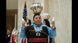 FILE - In this Feb. 1, 2019 file photo, Calela Lamy of Zuni Pueblo performs the pottery dance at the New Mexico Statehouse in Santa Fe, N.M. before the state adopted it's first Indigenous Peoples' Day. A handful of states, including New Mexico and Maine, are celebrating their first Indigenous Peoples' Day as part of a trend to move away from a day honoring Christopher Columbus. (AP Photo/Morgan Lee, File)