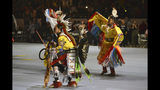 FILE - In this April 27, 2019 file photo, dancers enter at the Gathering of Nations, one of the world's largest gatherings of indigenous people in Albuquerque, N.M. A handful of states, including New Mexico and Maine, are celebrating their first Indigenous Peoples' Day as part of a trend to move away from a day honoring Christopher Columbus. (AP Photo/Russell Contreras, File)
