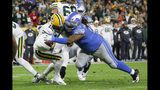 Green Bay Packers quarterback Aaron Rodgers (12) is sacked by Detroit Lions defensive tackle Damon Harrison during the second half of an NFL football game Monday, Oct. 14, 2019, in Green Bay, Wis. (AP Photo/Jeffrey Phelps)