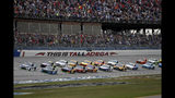 Chase Elliott (9) leads the pack to the start line for a NASCAR Cup Series auto race at Talladega Superspeedway in Talladega, Ala., Sunday, Oct. 13, 2019. (AP Photo/Butch Dill)
