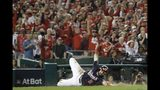 Washington Nationals' Adam Eaton scores on a hit by Anthony Rendon during the third inning of Game 3 of the baseball National League Championship Series against the St. Louis Cardinals Monday, Oct. 14, 2019, in Washington. (AP Photo/Jeff Roberson)