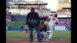 St. Louis Cardinals' Jose Martinez hits an RBI double during the eighth inning of Game 2 of the baseball National League Championship Series against the Washington Nationals Saturday, Oct. 12, 2019, in St. Louis. (AP Photo/Jeff Roberson)