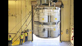 FILE - In this Tuesday, April 9, 2019 file photo, provided by Los Alamos National Laboratory, barrels of radioactive waste are loaded for transport to the Waste Isolation Pilot Plant, marking the first transuranic waste loading operations in five years at the Radioactive Assay Nondestructive Testing (RANT) facility in Los Alamos, N.M. A fight is raging in courts and Congress over where radioactive materials should be stored and how to safely get the dangerous remnants of decades of bomb-making and power generation to a permanent resting place. (Nestor Trujillo/Los Alamos National Laboratory via AP, File)