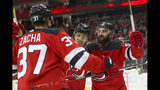 New Jersey Devils center Pavel Zacha (37) celebrates after scoring a goal with left wing Taylor Hall (9) and center Kyle Palmieri (21) during the second period of an NHL hockey game against the Florida Panthers, Monday, Oct. 14, 2019, in Newark, N.J. (AP Photo/Mary Altaffer)