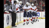 Florida Panthers right wing Brett Connolly (10) celebrates with teammates after scoring a second goal in the second period of an NHL hockey game against the New Jersey Devils, Monday, Oct. 14, 2019, in Newark, N.J. (AP Photo/Mary Altaffer)