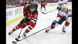 New Jersey Devils left wing Taylor Hall (9) skates against Florida Panthers defenseman Mike Matheson (19) during the second period of an NHL hockey game, Monday, Oct. 14, 2019, in Newark, N.J. (AP Photo/Mary Altaffer)