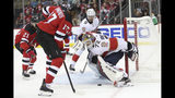 Florida Panthers goaltender Sergei Bobrovsky (72) makes the save against New Jersey Devils right wing Wayne Simmonds (17) during the second period of an NHL hockey game, Monday, Oct. 14, 2019, in Newark, N.J. (AP Photo/Mary Altaffer)