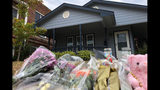 Bouquets of flowers and stuffed animals are piling up outside the Fort Worth home Monday, Oct. 14, 2019, where a 28-year-old black woman was shot to death by a white police officer. Members of the community have brought tributes to the home where Atatiana Jefferson was killed early Saturday by an officer who was responding to a neighbor's report of an open door. (AP Photo/Jake Bleiberg)