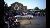 """A large crowd of protesters gather outside the house, right, where Atatiana Jefferson was shot Saturday and killed by police, during a community vigil for Jefferson on Sunday, Oct. 13, 2019, in Fort Worth, Texas. A white police officer who killed the black woman inside her Texas home while responding to a neighbor's call about an open front door """"didn't have time to perceive a threat"""" before he opened fire, an attorney for Jefferson's family said. (Smiley N. Pool/The Dallas Morning News via AP)"""