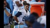 Tennessee Titans quarterback Marcus Mariota looks on from the sideline during the second half of an NFL football game against the Denver Broncos, Sunday, Oct. 13, 2019, in Denver. (AP Photo/David Zalubowski)