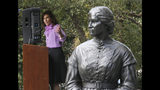 Former Virginia first lady Susan Allen gestures toward the statue of Elizabeth Keckly, seamstress and confidante to Mary Todd Lincoln, one of the seven statues unveiled at the dedication of the Virginia Women's Monument inside Capitol Square in Richmond, Va. Monday, Oct. 14, 2019. (Bob Brown/Richmond Times-Dispatch via AP)
