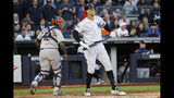 New York Yankees' Aaron Judge reacts after striking out against the Houston Astros to end the second inning in Game 3 of baseball's American League Championship Series Tuesday, Oct. 15, 2019, in New York. (AP Photo/Matt Slocum)
