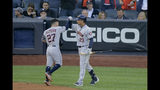 Houston Astros' Jose Altuve (27) is congratulated by Michael Brantley (23) after hitting a solo home run against the New York Yankees during the first inning of Game 3 of baseball's American League Championship Series, Tuesday, Oct. 15, 2019, in New York. (AP Photo/Seth Wenig)