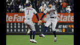 Houston Astros shortstop Carlos Correa, left, and center fielder George Springer celebrate after their 4-1 win against the New York Yankees in Game 3 of baseball's American League Championship Series Tuesday, Oct. 15, 2019, in New York. (AP Photo/Matt Slocum)
