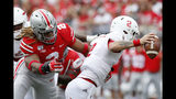 FILE - In this Aug. 31, 2019, file photo, Ohio State defensive end Chase Young, left, sacks Florida Atlantic quarterback Chris Robison during an NCAA football game, in Columbus, Ohio. Young was selected to the AP Midseason All-America NCAA college football team, Tuesday, Oct. 15, 2019. (AP Photo/Paul Vernon, File)