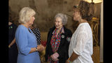 Britain's Camila The Duchess of Cornwall talks with 2019 Booker prize joint winners Margaret Atwood, centre, and Bernardine Evaristo, right, during a reception for the Booker Prize Foundation at Clarence House in London, Tuesday Oct. 15, 2019. (Aaron Chown/PA via AP)