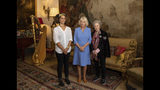 Britain's Camila The Duchess of Cornwall poses for photographs with 2019 Booker prize joint winners Margaret Atwood, right, and Bernardine Evaristo, left, during a reception for the Booker Prize Foundation at Clarence House in London, Tuesday Oct. 15, 2019. (Aaron Chown/PA via AP)