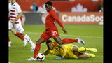 United States goalkeeper Zack Steffen (1) watches as Canada forward Jonathan David (20) lines up a shot on net during the first half of a CONCACAF Nations League soccer match Tuesday, Oct. 15, 2019, in Toronto. (Cole Burston/The Canadian Press via AP