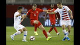 Canada midfielder Samuel Piette (6) tries to fend off U.S. midfielder Cristian Roldan (15) and forward Jordan Morris (11) during the first half of a CONCACAF Nations League soccer match Tuesday, Oct. 15, 2019, in Toronto. (Cole Burston/The Canadian Press via AP)