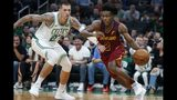 Cleveland Cavaliers' Collin Sexton (2) drives past Boston Celtics' Daniel Theis (27) during the first half of an NBA preseason basketball game in Boston, Sunday, Oct. 13, 2019. (AP Photo/Michael Dwyer)