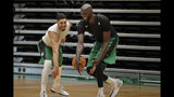 Boston Celtics centers Enes Kanter, left, and Tacko Fall play one-on-one during the NBA basketball team's training camp, Tuesday, Oct. 1, 2019 in Boston. (AP Photo/Elise Amendola)