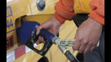 An employee of a gas station fills the fuel tank of a taxi in Quito, Ecuador, Tuesday, Oct. 15, 2019. The recent strike that paralyzed the Andean nation for almost two weeks, has left a gaping hole in Ecuador's economy, this after President Lenin Moreno called back his elimination of fuel subsidies which provoked the violent protests. (AP Photo/Dolores Ochoa)