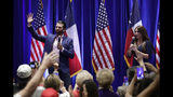 Donald Trump, Jr., left, and Trump campaign senior adviser Kimberly Guilfoyle, right, speak to supporters of President Donald Trump during a panel discussion, Tuesday, Oct. 15, 2019, in San Antonio. (AP Photo/Eric Gay)