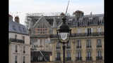 """Notre Dame cathedral is pictured Tuesday, Oct. 15, 2019 in Paris. French Culture Minister Franck Riester said the melted, twisted scaffolding atop Notre Dame Cathedral will be removed """"in coming weeks"""" to allow restoration work to begin. It's been six months since fire gutted the medieval structure, which was under renovation at the time and crisscrossed with scaffolding where the spire once stood. (AP Photo/Michel Euler)"""