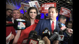 FILE- In this Nov. 6, 2018 file photo, Florida Govenor-elect Ron DeSantis, right, answers questions from reporters, with his wife Casey, after being declared the winner of the Florida gubernatorial race at an election party, in Orlando, Fla. Standing behind Casey DeSantis is Lev Parnas. Parnas and his associate Igor Furman are facing federal charges in connection to efforts by President Donald Trump's lawyer, Rudy Giuliani, to launch a Ukrainian corruption investigation agains Joe Biden and his son, Hunter. (AP Photo/Phelan M. Ebenhack, File)