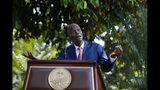 President Jovenel Moïse speaks during a press conference at the National Palace in Port-au-Prince, Haiti, Tuesday, Oct. 15, 2019. Haiti's embattled president faced a fifth week of protests as road blocks and marches continue across the country, after opposition leaders said they will not back down on their call for Moïse to resign. (AP Photo/Rebecca Blackwell)