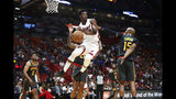 Miami Heat forward Jimmy Butler (22) passes the ball against Atlanta Hawks guard Vince Carter (15) during the second half of an NBA preseason basketball game Monday, Oct. 14, 2019, in Miami. (AP Photo/Brynn Anderson)