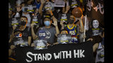 Demonstrators hold up signs in support of Houston Rockets general manager Daryl Morey during a rally at the Southorn Playground in Hong Kong, Tuesday, Oct. 15, 2019. Protesters in Hong Kong have thrown basketballs at a photo of LeBron James and chanted their anger about comments the Los Angeles Lakers star made about free speech during a rally in support of NBA commissioner Adam Silver and Houston Rockets general manager Daryl Morey, whose tweet in support of the Hong Kong protests touched off a firestorm of controversy in China. (AP Photo/Mark Schiefelbein)