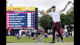 Lanto Griffin drops his putter and throws his arms up after sinking his final putt to win the Houston Open golf tournament Sunday, Oct, 13, 2019, in Houston. (AP Photo/Michael Wyke)