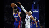 Detroit Pistons' Luke Kennard (5) shoots as Philadelphia 76ers' Tobias Harris defends during the second half of an NBA preseason basketball game Tuesday, Oct. 15, 2019, in Philadelphia. The 76ers won 106-86. (AP Photo/Matt Rourke)