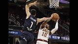 Cleveland Cavaliers' Darius Garland (10) shoots over San Lorenzo de Almagro's Agustin Caffaro (1) in the first half of an NBA preseason basketball game, Monday, Oct. 7, 2019, in Cleveland. (AP Photo/Tony Dejak)
