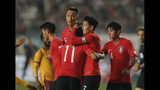 South Korea's Son Heung-min, center, celebrates with his teammates after scoring against Sri Lanka during their Asian zone Group H qualifying soccer match for the 2022 World Cup at Hwaseong Sports Complex in Hwaseong, South Korea, Thursday, Oct. 10, 2019. (AP Photo/Lee Jin-man)