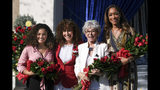 Grand Marshall Laurie Hernandez, from left, Tournament of Roses President Laura Farber, Grand Marshall Rita Moreno and Grand Marshall Gina Torres appear at the tournament house in Pasadena, Calif., on Tuesday, Oct. 15, 2019. Hernandez, Moreno and Torres will be the Grand Marshals for the 2020 Pasadena Tournament of Roses Parade. (David Crane/The Orange County Register via AP)
