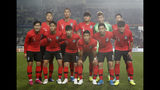 In this Oct. 10, 2019, photo, South Korea's national soccer team players front row from left, Lee Kang-in, Paik Seung-ho, Kim Moon-hwan, Hwang Hee-chan, Nam Tae-hee, Hong Chul, and back row from left, Kwon Kyung-won, Kim Shin-wook, Kim Min-jae, Jo Hyeon-woo, Son Heung-min pose prior to the start of the their Asian zone Group H qualifying soccer match between South Korea and Sri Lanka for the 2022 World Cup at Hwaseong Sports Complex Main Stadium in Hwaseong, South Korea. (AP Photo/Lee Jin-man)