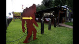 In this Aug. 8, 2019, photo, a cutout of a Bigfoot directs visitors to the entrance of Expedition: Bigfoot! The Sasquatch Museum in Cherry Log, Ga. The owner of this intriguing piece of Americana at the southern edge of the Appalachians is David Bakara, a longtime member of the Bigfoot Field Researchers Organization who served in the Navy, drove long-haul trucks and tended bar before opening the museum in early 2016 with his wife, Malinda. (AP Photo/John Bazemore)