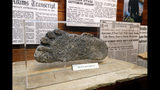 This Aug. 8, 2019, photo shows a plaster cast of footprints believed to be made by a Bigfoot on display at Expedition: Bigfoot! The Sasquatch Museum in Cherry Log, Ga. The owner of this intriguing piece of Americana at the southern edge of the Appalachians is David Bakara, a longtime member of the Bigfoot Field Researchers Organization who served in the Navy, drove long-haul trucks and tended bar before opening the museum in early 2016 with his wife, Malinda. (AP Photo/John Bazemore)