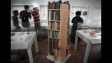 "A revolving bookshelf displays bedside books often read by author J.D. Salinger, Wednesday, Oct. 16, 2019, in New York. The books are part of an exhibit, titled ""JD Salinger,"" that draws from archives made available by the author's family and helps mark the centennial of his birth. (AP Photo/Bebeto Matthews)"