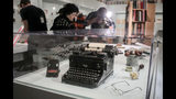 "A typewriter, tobacco pipes, and eye glasses are part of a J.D. Salinger exhibit being installed at the New York Public Library, Wednesday, Oct. 16, 2019, in New York. The exhibit, titled ""JD Salinger,"" opens Friday and draws from archives made available by the author's family and helps mark the centennial of his birth. (AP Photo/Bebeto Matthews)"