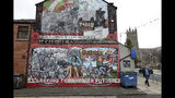 In this Tuesday, Oct. 15, 2019 photo showing a Loyalist mural painted on a wall in east Belfast, Northern Ireland. (AP Photo/Peter Morrison)